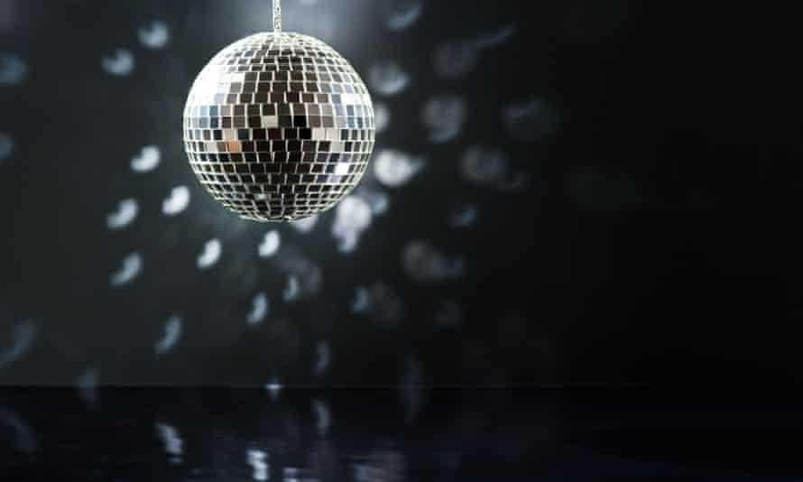 A mirrorball over a dancefloor