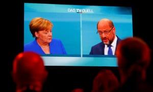 Journalists watch the TV debate between Angela Merkel and Martin Schulz in Berlin, Germany.