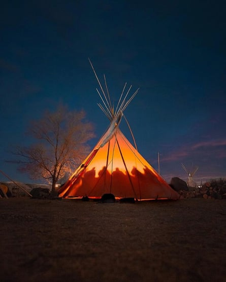 Women water protectors gather to strategize at nightfall.