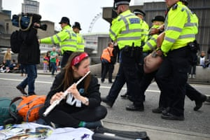 Police remove protesters from Waterloo Bridge