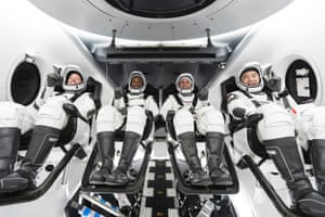 NASA astronauts Shannon Walker, Victor Glover, Mike Hopkins, and JAXA (Japan Aerospace Exploration Agency) astronaut Soichi Noguchi at NASAs Kennedy Space Center in Florida.