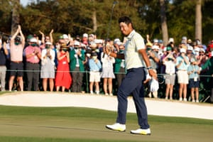 Japan's Hideki Matsuyama celebrates on the 18th green ahead of winning The Masters.