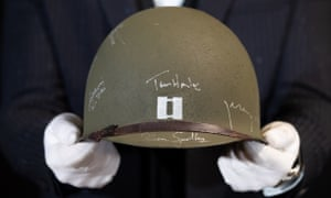 The helmet worn by Tom Hanks as Capt Miller, which has been signed by the cast of 1998's Saving Private Ryan, estimated at £10,000-£15,000