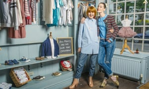 Mary Portas with model Erin O'Connor in one of her charity shops, painted pale blue, selling baby and young children's clothes