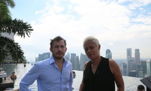 Giles Coren and Monica Galetti by the pool at the Marina Bay Sands Hotel, Singapore - (C) BBC - Photographer: BBC