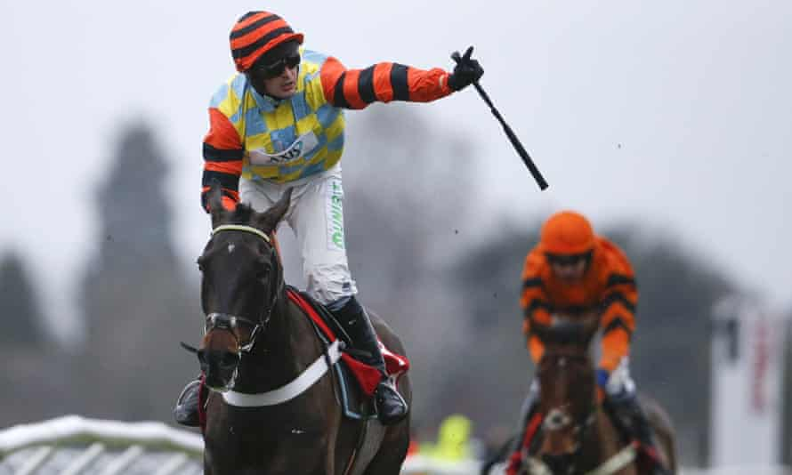 Nico de Boinville rides Might Bite to victory in the King George at Kempton.