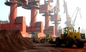 Workers transport soil containing rare earth elements for export at a port in Lianyungang, Jiangsu province, China