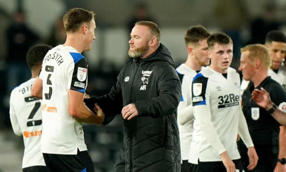 Derby County manager Wayne Rooney congratulates Craig Forsyth after the defender's first goal in 105 games.
