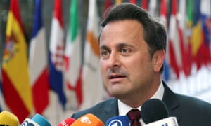 Xavier Bettel speaks to the media as he arrives at the summit.