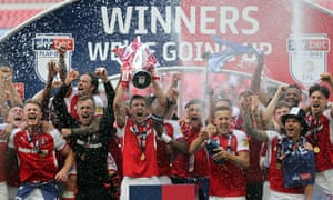 Rotherham celebrate winning the League One Play-Off Final with the trophy.