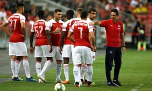 Unai Emery alongside some of his players during Arsenal's pre-season match against Atlético Madrid in Singapore. The Spaniard is Arsenal's first new manager in over two decades