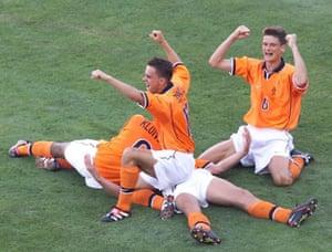 Patrick Kluivert, Marc Overmars and Wim Jonk celebrate with Bergkamp.