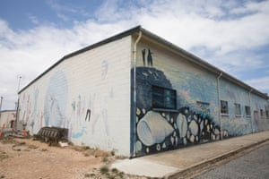 A mural of the history of Elliston on a building