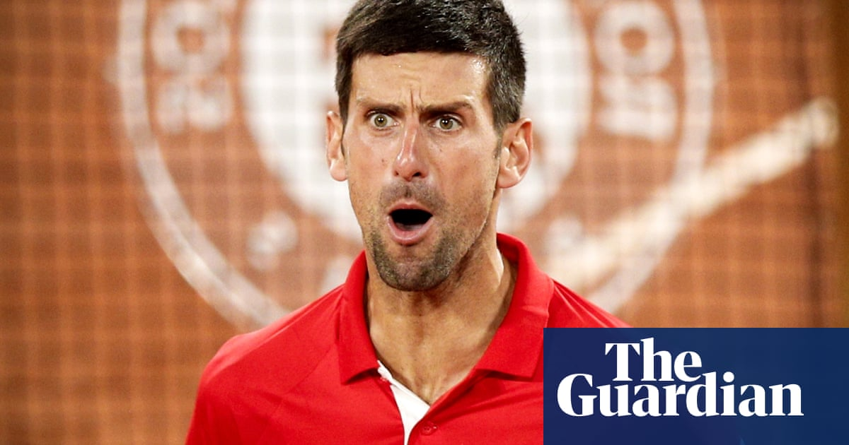 Djokovic shuts out French Open silence and boos to set up Nadal semi-final