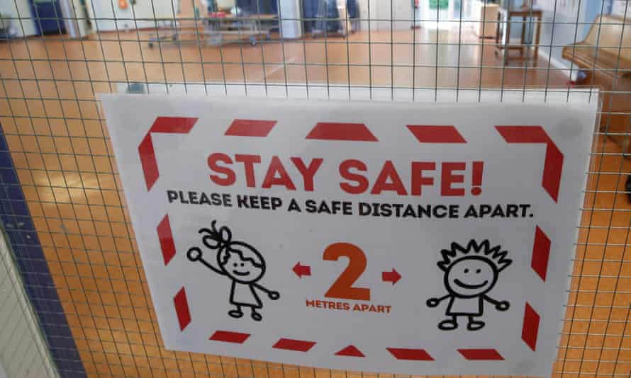 A 'stay safe' sign on a school door