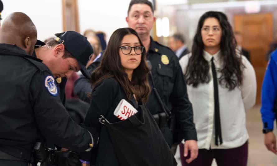 Protesters are arrested outside the confirmation hearing of Andrew Wheeler, nominee to be Environmental Protection Agency administrator.