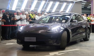 China-made Tesla Model 3 vehicle is seen at a delivery ceremony in the Shanghai gigafactory of the U.S. electric carmaker