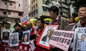 Protestors hold up missing person notices during a demonstration over the missing Mighty Current publishers in Hong Kong.