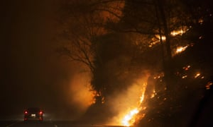 A fire rages next to Highway 441 near Gatlinburg, Tennessee.