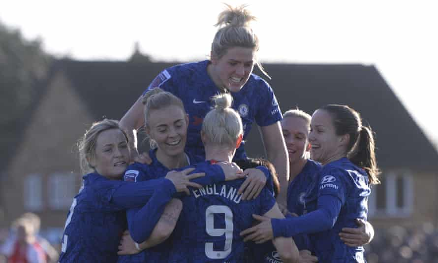 Chelsea players celebrate with Beth England after her opening goal at Meadow Park