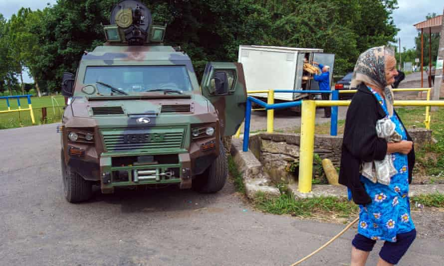 Life goes on in a village near Mukacheve as Ukrainian security forces search for militia fighters of the far-right militia Right Sector. At least two people were killed at the weekend.