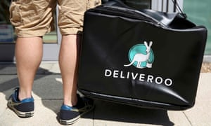 A Deliveroo worker making a delivery.