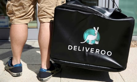 A Deliveroo worker makes a delivery