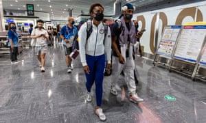 Members of the US Olympics delegation leaving Tokyo at Narita international airport on Monday.