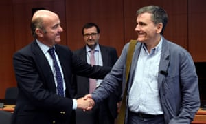 Greek Finance Minister Euclid Tsakalotos (right) has persuaded his eurozone colleagues to finally unlock bailout loans for Athens