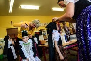 Sorbian dressmaker Petra Kupke decorates a child