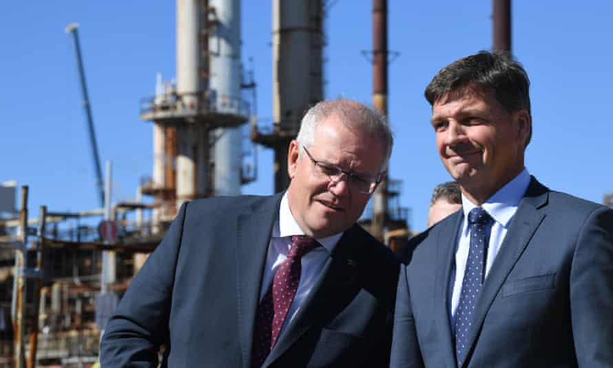 Australian prime minister Scott Morrison (left) and energy minister Angus Taylor (right) are seen during a tour of the Ampol Lytton Refinery in Brisbane, 17 May 2021.