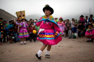 A woman performs an indigenous dance called Huaylia marking the Day of the Dead holiday in Lima