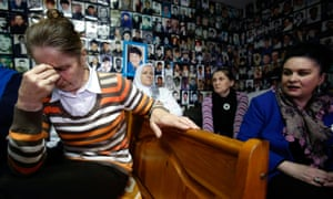 Survivors of the Srebrenica massacre react as they watch a live broadcast of the verdict in the Radovan Karadžić trial