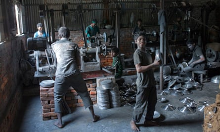 Children as young as 10 are seen operating heavy machinery in a factory in Dhaka, Bangladesh.