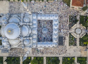 A drone photo shows an aerial view of the Fatih Mosque in Istanbul, Turkey, as Muslims gather to perform Eid al-Adha prayer obeying social distance rules amid Covid pandemic precautions