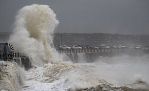 Waves crash into the breakwater in Newhaven