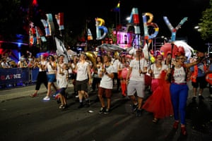 Gayby babies walk Mardi Gras.