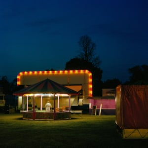 """Clapham - Taken late on a Sunday night on Clapham Common, the fair was packing up and heading on to it's next destination - mostly likely another park somewhere across south London.""""Many of the early shots in the series were made in the late evening and into the night. I used to drive around trying to make visual sense of neighbourhoods such as Mitcham, Colliers Wood, and Tooting - areas that always seemed to be overlooked in the contemporary history of the capital."""""""