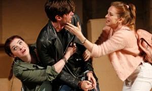 Olivia Brereton as Lucy Lockit, Benjamin Purkiss as Macheath and Kate Batter as Polly Peachum in The Beggar's Opera, at Kings Theatre, Edinburgh international festival 2018.