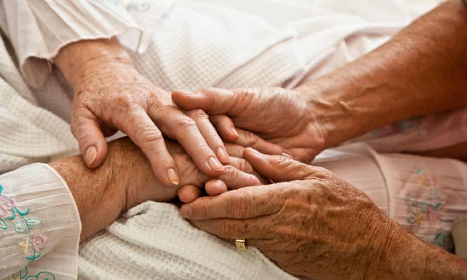 Two Old People Holding Hands
