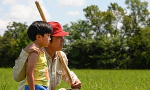 Alan S Kim and Steven Yeun in Minari. Lee Isaac Chung's nuanced portrait of a family figuring out their place in the world is both small and somehow rather grand.