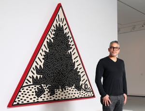 Gil Vazquez, president of the Keith Haring Foundation, in front of Pile of crowns for Jean-Michel Basquiat at the NGV.