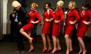 Richard Branson and some Virgin flight attendants