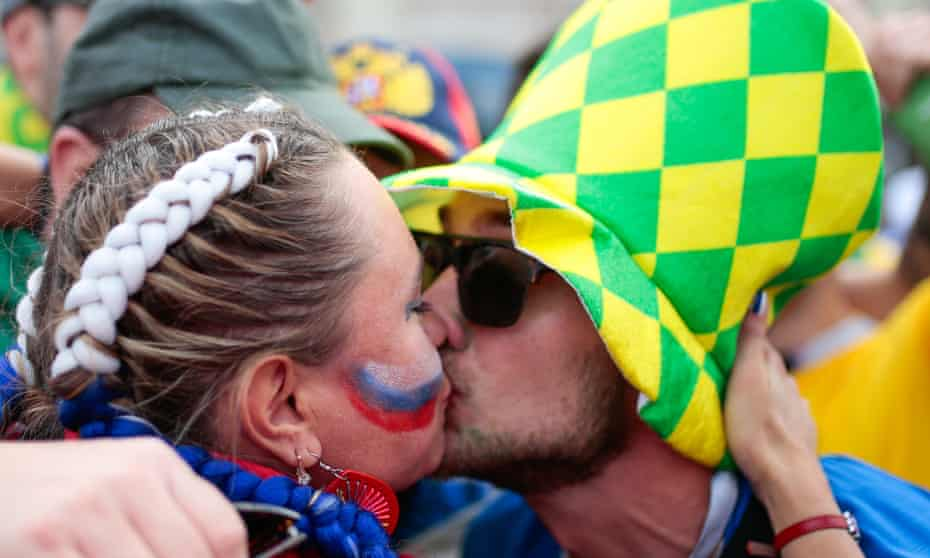 Fans kissing outside Luzhniki Stadium ahead of the first match of the World Cup.