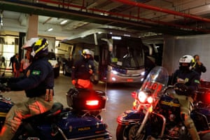 Brazilian police officers are seen in the parking garage at the stadium in front of the Argentina team bus. It looks like they'll be off soon.
