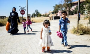 Syrian refugees on their way to the city of Jarabulus.