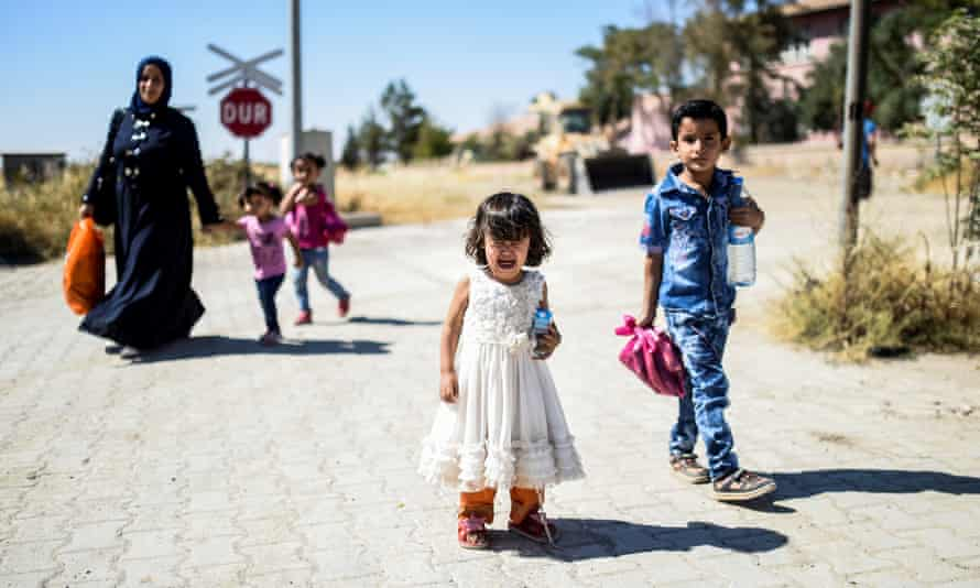 Refugees outside the city of Jarabulus in Syria.