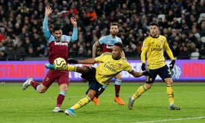 Pierre-Emerick Aubameyang connects to score Arsenal's third in ten minutes.