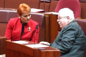 Pauline Hanson talks to Barry O'Sullivan during debate in the senate chamber of parliament house Canberra this morning.
