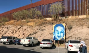 A portrait of 16-year-old Mexican youth Jose Antonio Elena Rodriguez is displayed on the street where he was killed that runs parallel with the US border.
